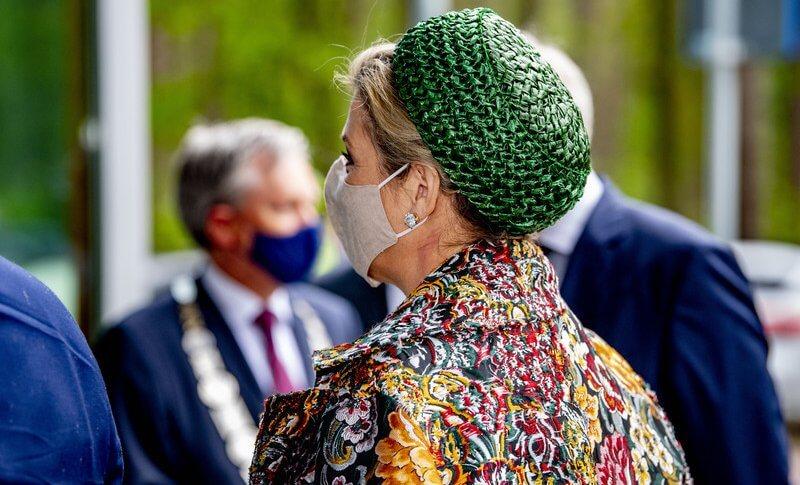 Queen Maxima wore a long floral brocade coat from Oscar de la Renta. and new green dress from Natan