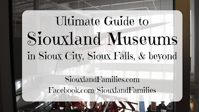 "in background, a small red airplane soars suspended from the ceiling of the Sioux City Public Museum. In foreground, the words ""Ultimate Guide to Siouxland Museums in Sioux City, Sioux Falls, and beyond"""