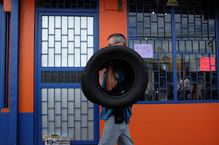 man with tire in Santiago de Puriscal