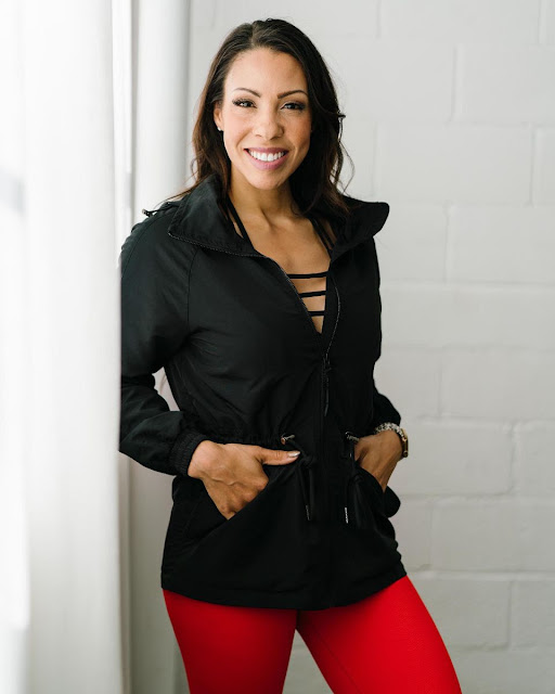 Black Zyia Active jacket with hood long and cinched waist