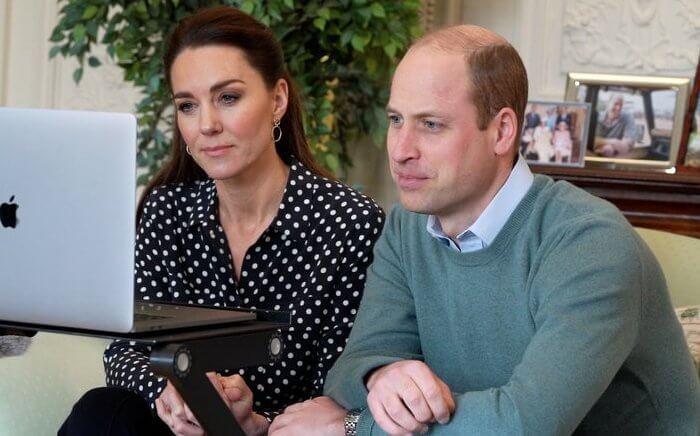 Kate Middleton wore a slim signature polka dot silk shirt from Equipment, and high waisted trousers from Jigsaw. Accessorize cicrcle drop earrings