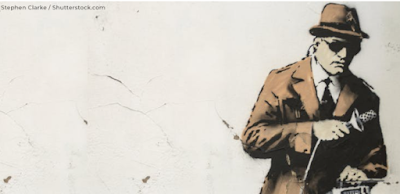 What is the name of the artist known for street art like this – often making commentary on society?
