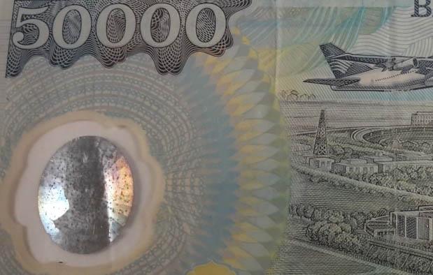 Perbedaan Uang Asli dan Uang Palsu