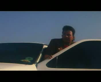 Shankar emerges from the passenger side of the car