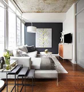 Fabulous White Modern Sofa Bed in the Living Room with White Rounded Table and Grey Carpet