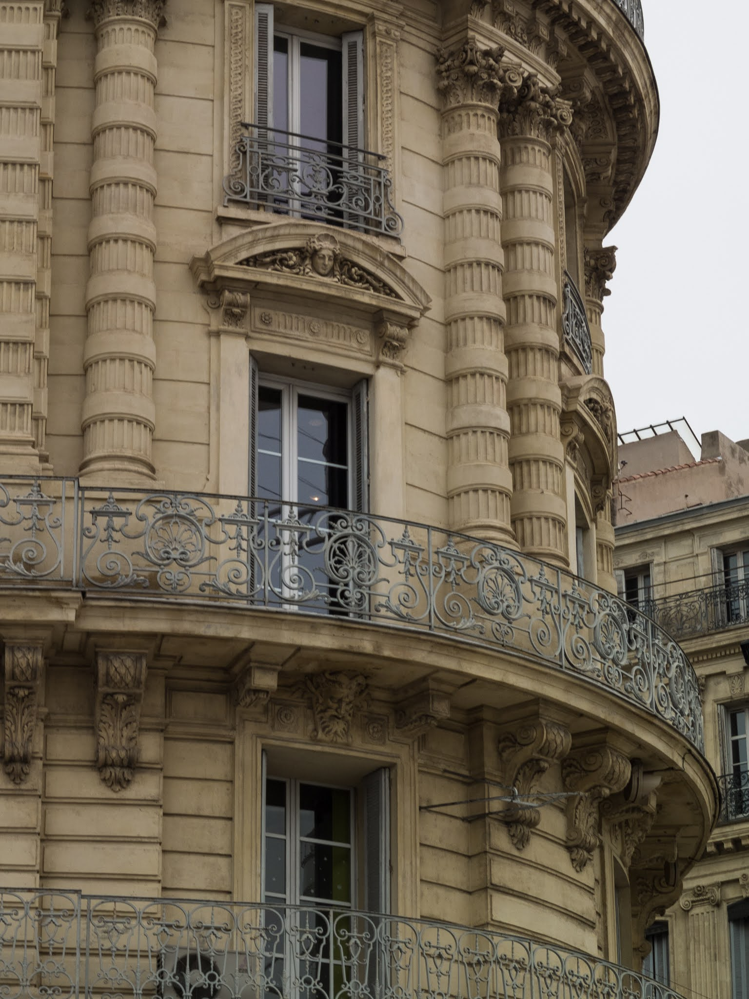 A close up of a curved building on Les quais du Port in Marseille, Southern France.