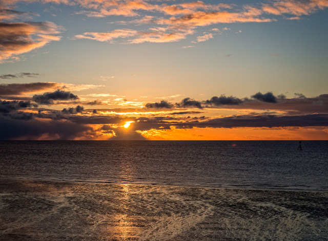 Photo of sunset across the Solway Firth from Maryport shore