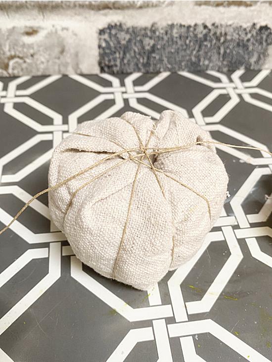 string wrapped around pumpkin