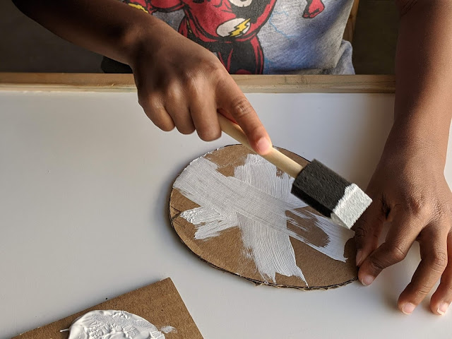 African-American boy painting