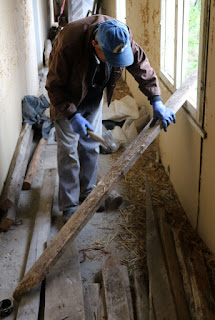 Sally sorting more wood for the roof