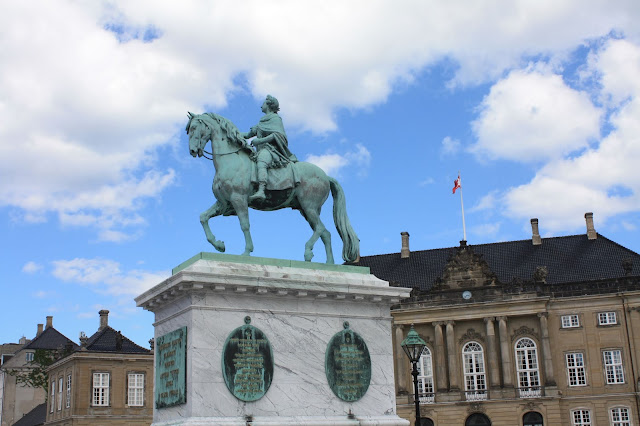 King Frederik V rises above the courtyard at Amalienborg Palace