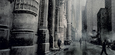 Man walking into large grey columned building