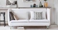White sofa with throw pillows for apartment living room