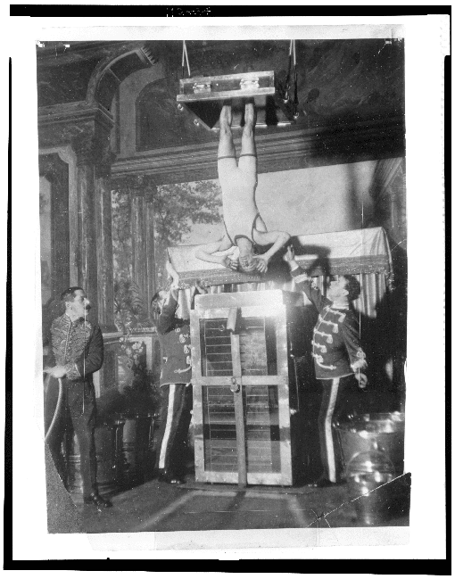 """Harry Houdini performs """"Water Torture""""   Photo courtesy of the Breman Museum"""