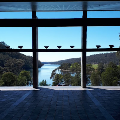 View from inside the great room of the Boyd Education Centre looking out across the river and bush.