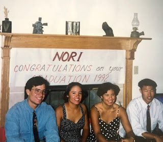 A graduation celebration 1992 of four racially ambiguous kids