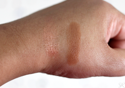 a swatch of a bronze highlighter on a woman's hand