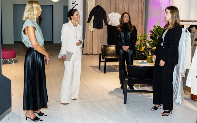 Crown Princess Victoria wore cream suit by Andiata. Kreuger Jewellery summer feather earrings. By Malene Birger Koonia clutch