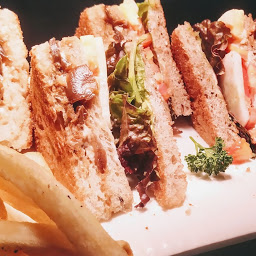 Serving veg club sandwich with fries and coleslaw for veg club sandwich recipe