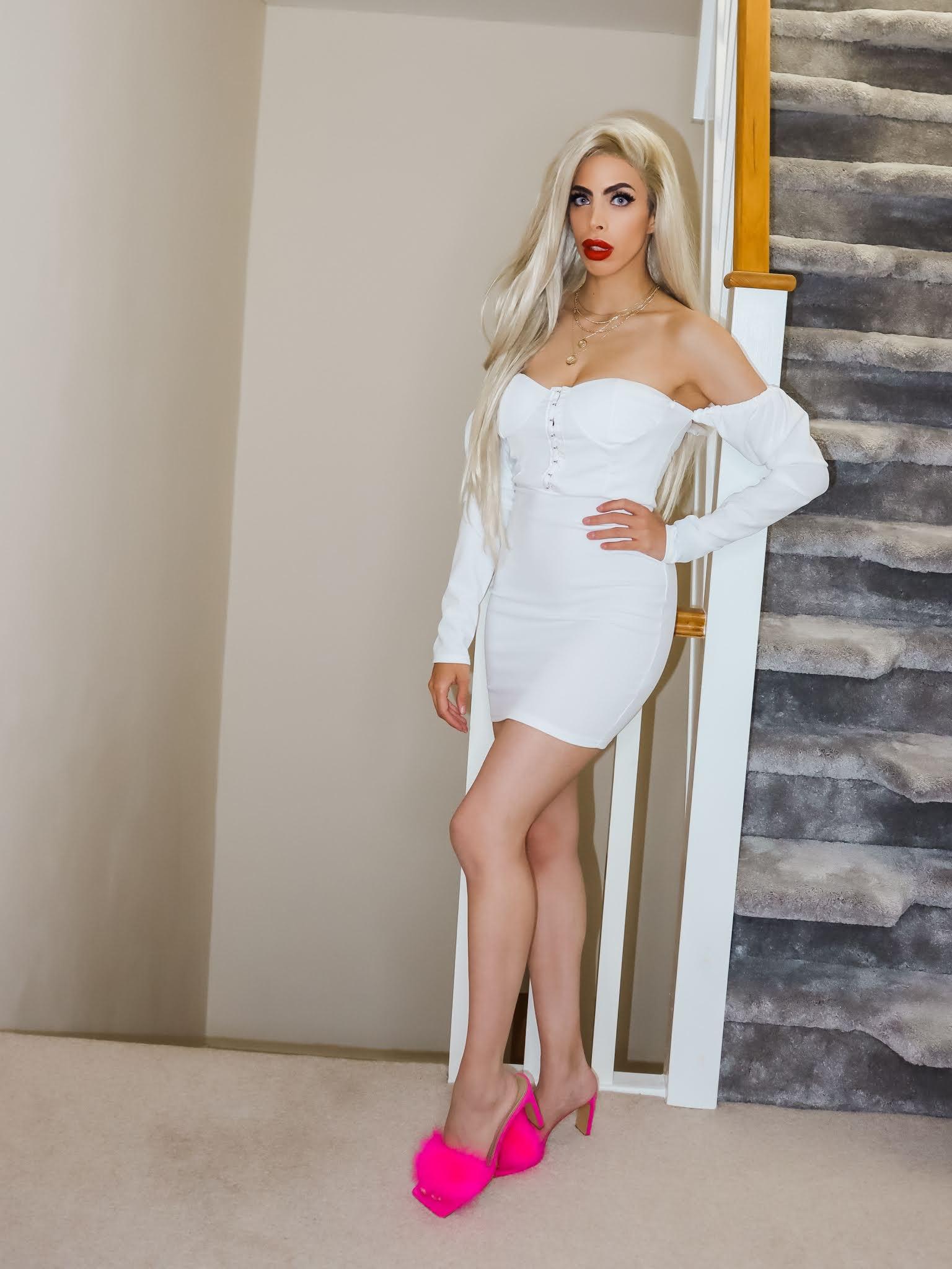 The Femme Luxe White Milkmaid Bodycon Mini Dress in model Elettra