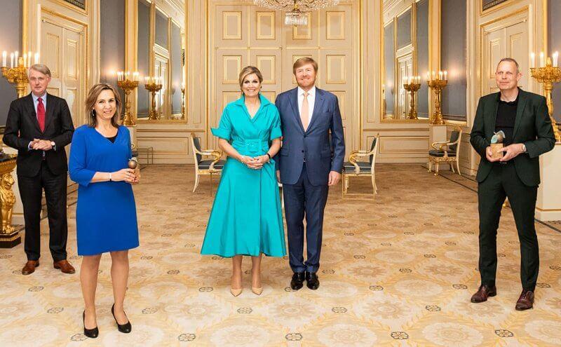 Queen Maxima wore a new blue Taffeta shirt dress from Natan, blue diamond earrings