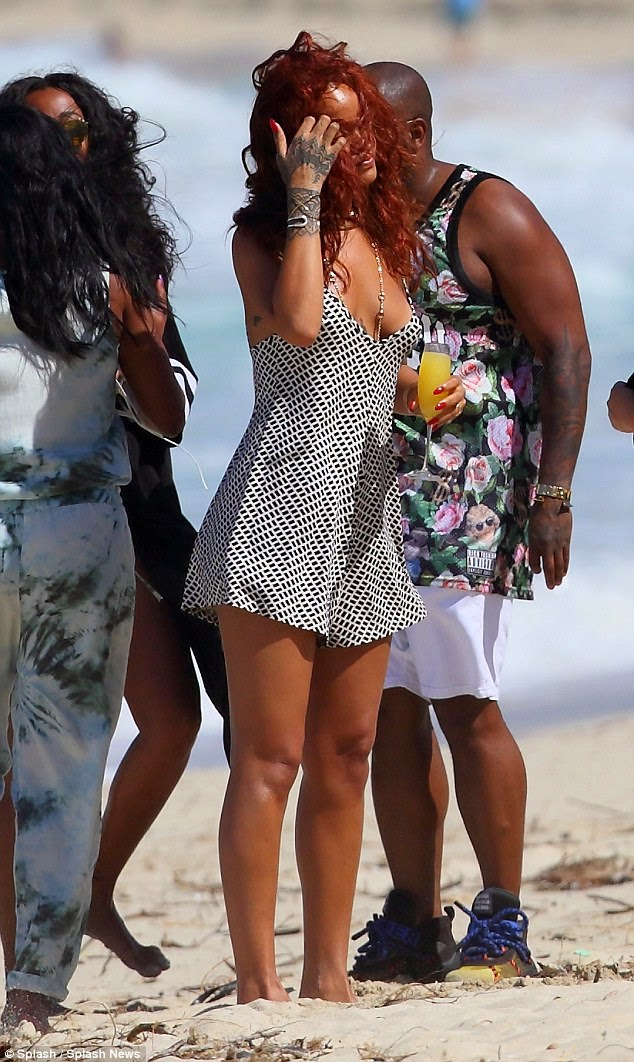 Nigerian Magazine Rihanna Goes To The Beach In A Short Dress