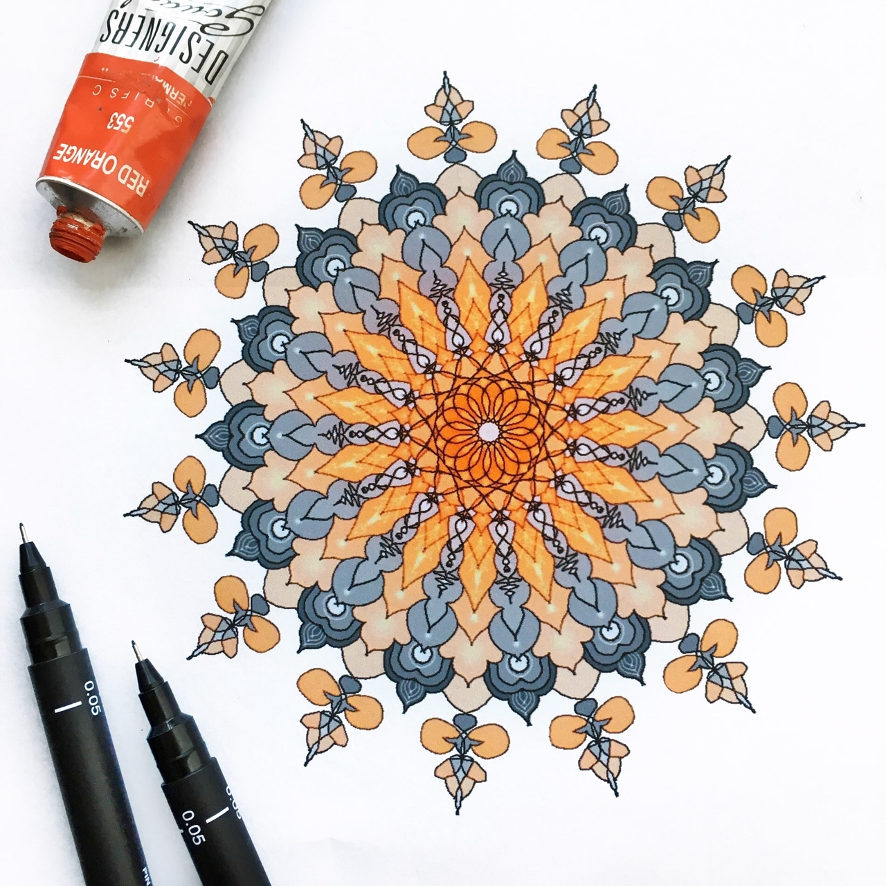 12-Orange-Chakra-Dilrani-Kauris-Symmetry-and-Style-in-Mandala-and-Mehndi-Drawings-www-designstack-co