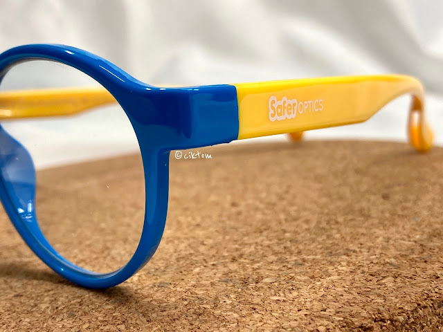 Children blue light glasses in cute blue yellow by SaferOptics