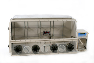 Rigid anaerobic chamber glove box with airlock
