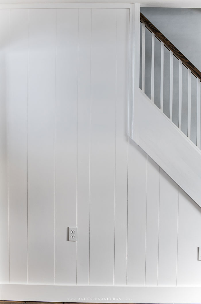 Empty white wall with staircase