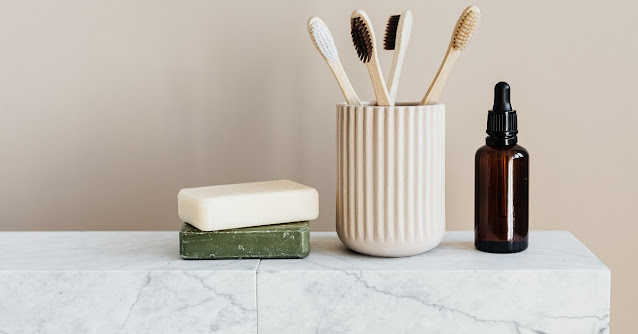 Composite marble on a countertop with toothbrushes and soap.