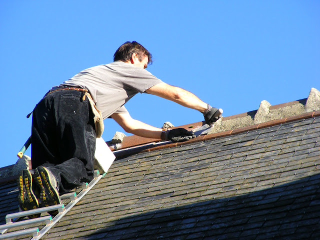 Sculpting a roof crest repair, Indre et Loire, France. Photo by Loire Valley Time Travel.