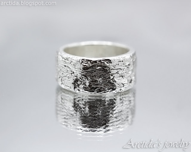 https://www.arctida.com/en/home/132-carved-massive-ring-with-tree-bark-texture-wide-band.html