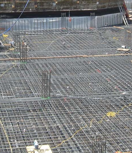 A massive mat foundation is reinforcing with steel before concreting