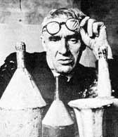 Giorgio Morandi pictured in his studio in Bologna in 1953