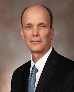 A portrait style photo of Dr. Paul Hemmer