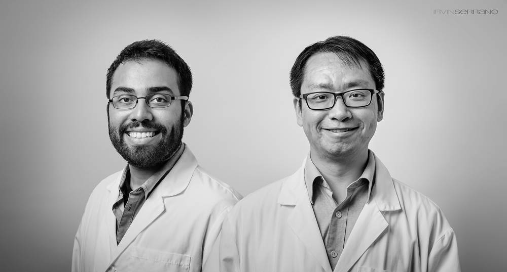 A black and white portrait of two scientists, Dr. Xu and Steve Ramirez, in lab coats.