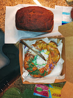 Loaf of freshly baked bread next to small King Cake
