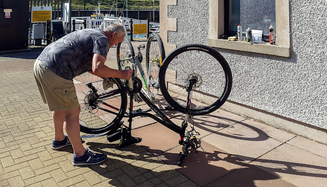 Photo of Phil carrying out bike checks