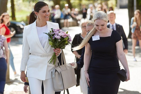 Crown Princess Victoria wore H&M Jacket with Tie Belt and H&M trousers at Tobias Registry's anniversary ceremony at Lund University Stockholm