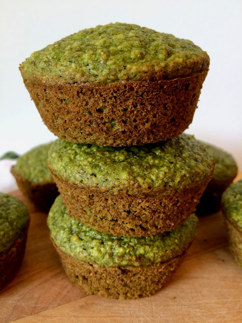 Stack of baked spinach banana oat muffins.