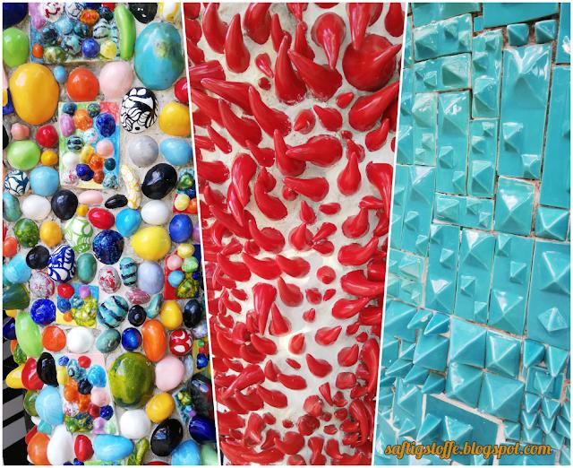 Niki de Saint-Phalle Kunst, bunte Steinmosaik-Säulen, Tarot-Garten