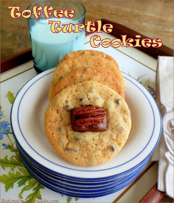 Toffee Turtle Cookies are a cookie reminiscent of a well known candy treat. Pecan and mini chocolate chip cookies are topped with a miniature toffee and pecan half. | Recipe developed by www.BakingInATornado.com | #recipe #chocolate
