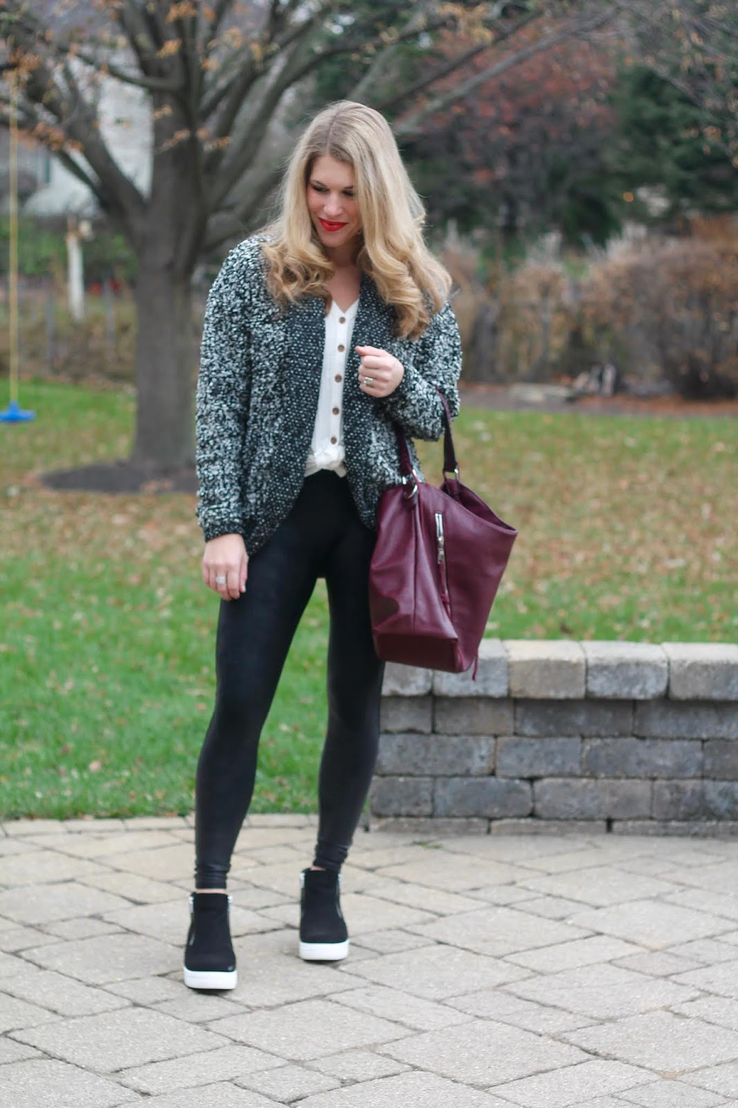 aventura henley, spanx leather leggings, burgundy slouch bag, space dye cardigan, wedge sneakers,