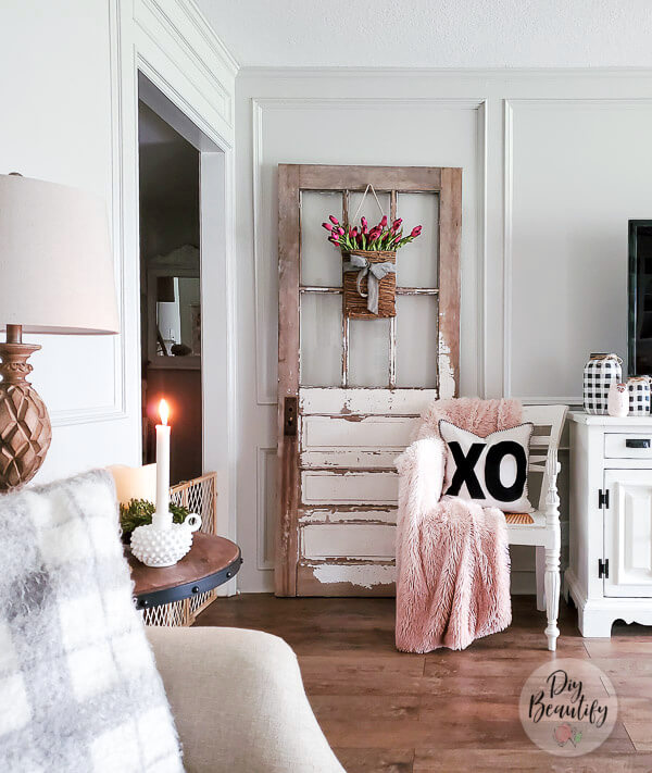 farmhouse living room with antique door and blush accents