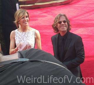 Felicity Huffman William Macy smile at the fans in the bleachers at the Emmys
