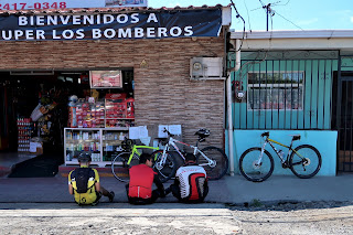 Bicyclists in front of store in Puriscal
