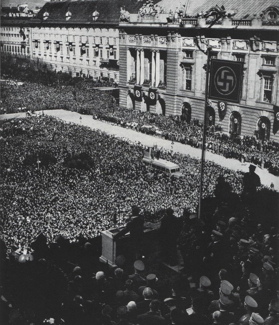 Austrian citizens gather in the Heldenplatz to hear Hitler's declaration of annexation