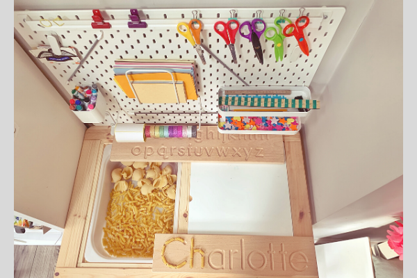 Ikea flisat table skadis pegboard desk with one side open and pasta in the trofast tray