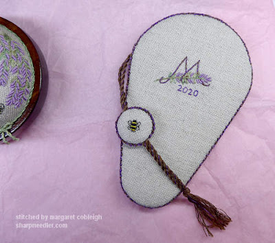 Embroidered initial and date on back of scissors keeper along with other side of fob with embroidered bee